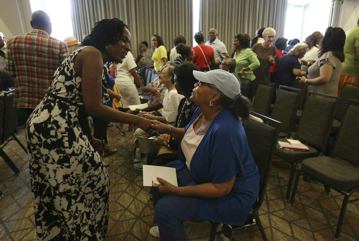 Danette Brown (seated) and Deborah Butler greet one another as local NAACP volunteers gather at the Grand Hyatt for training and orientation on Saturday, June 9, 2018 to get ready for the organization's national convention in San Antonio in July. Organizers expect 8,000 to 10,000 people will attend the five-day convention, which is in its 109th year. (Kin Man Hui/San Antonio Express-News)