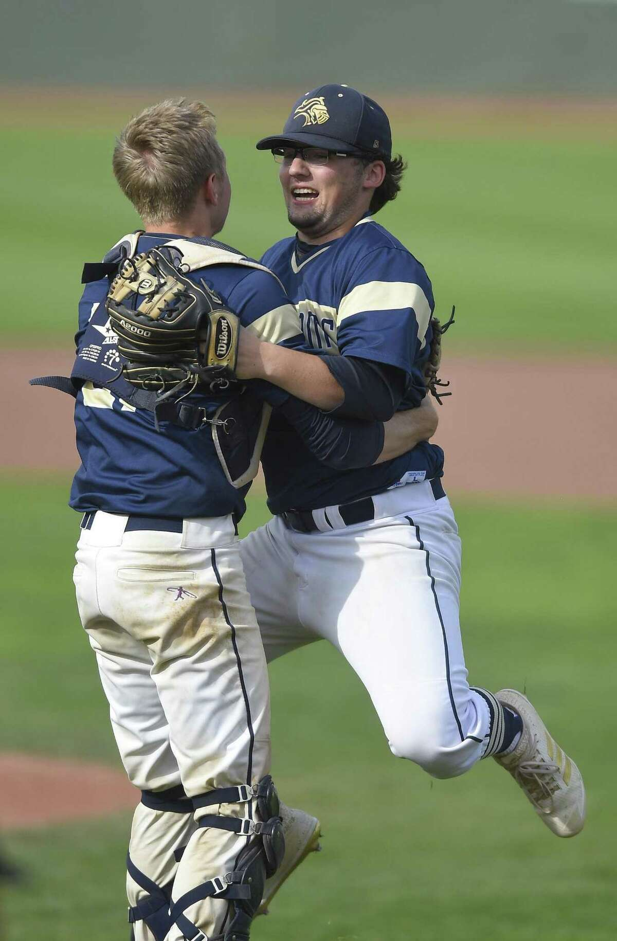 Notre Dame-Fairfield pitcher Dillon Higgins (2) leaps into the arms of catcher Jacob Rainey (21) after delivering the game winning strike out in the seventh inning Coventry's Nik Freschlin (27) in the CIAC Class S baseball finals at Palmer Field Stadium on June 9, 2018 in Middletown, Connecticut. Notre Dame-Fairfield defeated Coventry 10-6.