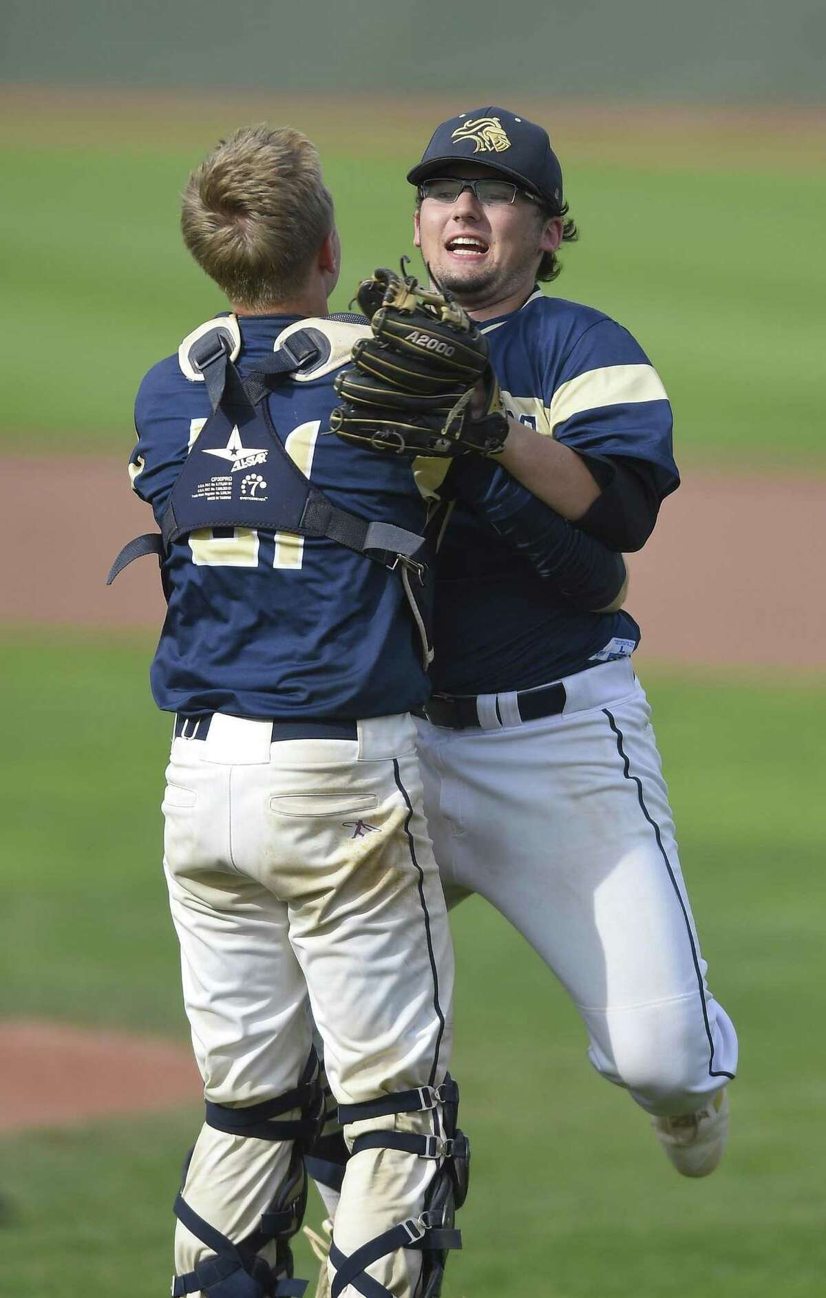 Notre Dame-Fairfield pitcher Dillon Higgins (2) leaps into the arms of catcher Jacob Rainey (21) after delivering the game winning strike out in the seventh inning Coventry's Nik Freschlin (27) in the CIAC Class S baseball finals at Palmer Field Stadium on June 9, 2018 in Middletown, Connecticut. Notre Dame-Fairfielde defeated Coventry 10-6.