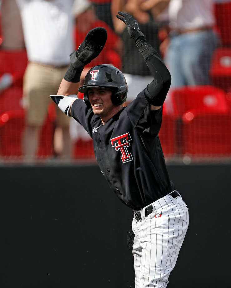 Texas Tech's Gabe Holt celebrates after scoring the final run during an NCAA college baseball tournament super regional game against Duke, Saturday, June 9, 2018, in Lubbock, Texas. (Brad Tollefson/Lubbock Avalanche-Journal via AP)