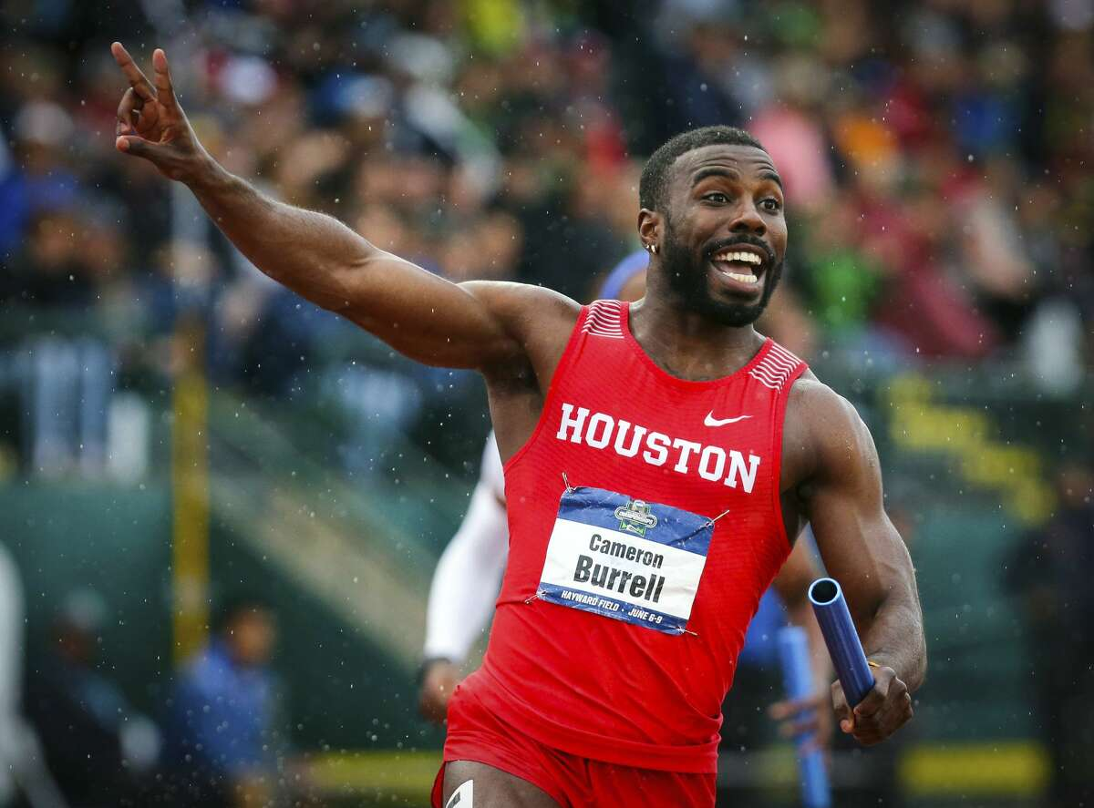 Houston's Cameron Burrell raises two fingers to indicate Houston's back-to-back men's 400-meter relay wins, during the third day of the NCAA Outdoor Track and Field Championships at Hayward Field on Friday, June 8, 2018, in Eugene, Ore. (Andy Nelson/The Register-Guard via AP)