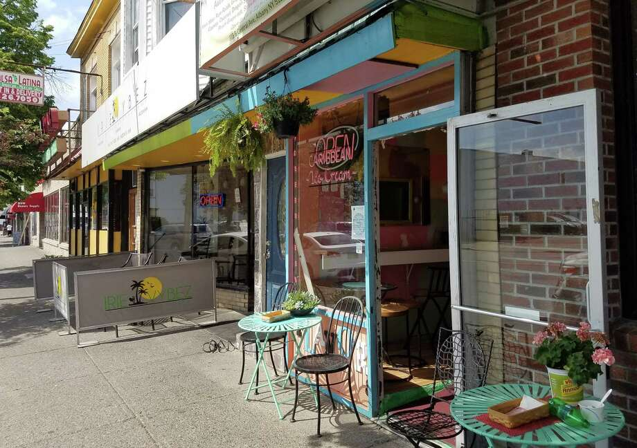 Storefronts, including Flavors, a Caribbean ice cream shop, along Albany's Central Avenue. (Chris Churchill / Times Union)