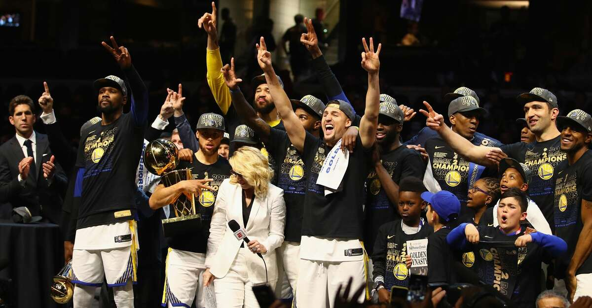 CLEVELAND, OH - JUNE 08: Kevin Durant #35 of the Golden State Warriors celebrates with the MVP trophy as Stephen Curry #30 celebrates with the Larry O'Brien Trophy after defeating the Cleveland Cavaliers during Game Four of the 2018 NBA Finals at Quicken Loans Arena on June 8, 2018 in Cleveland, Ohio. The Warriors defeated the Cavaliers 108-85 to win the 2018 NBA Finals. NOTE TO USER: User expressly acknowledges and agrees that, by downloading and or using this photograph, User is consenting to the terms and conditions of the Getty Images License Agreement. (Photo by Gregory Shamus/Getty Images)