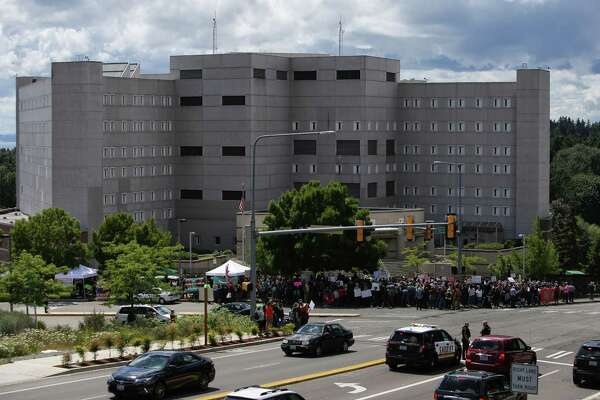 Several hundred protesters and elected officials including Washington State Governor Jay Inslee, State Attorney General Bob Ferguson and U.S. Rep. Pramila Jayapal (D-Seattle), gather at the Federal Detention Center in SeaTac where 174 women are being held, most of whom fled Central America to seek political asylum in the U.S., June 9, 2018. According to Jayapal, who met with the women Saturday, many said their children were taken from them after they crossed the border into Texas. The protest included speeches, sign making, letter writing, and music.