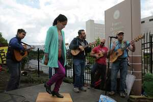 Seattle Fandango Project performs as several hundred protesters and elected officials including Washington State Governor Jay Inslee, State Attorney General Bob Ferguson and U.S. Rep. Pramila Jayapal (D-Seattle), gather at the Federal Detention Center in SeaTac where 174 women are being held, most of whom fled Central America to seek political asylum in the U.S., June 9, 2018.  According to Jayapal, who met with the women Saturday, many said their children were taken from them after they crossed the border into Texas. The protest included speeches, sign making, letter writing, and music.