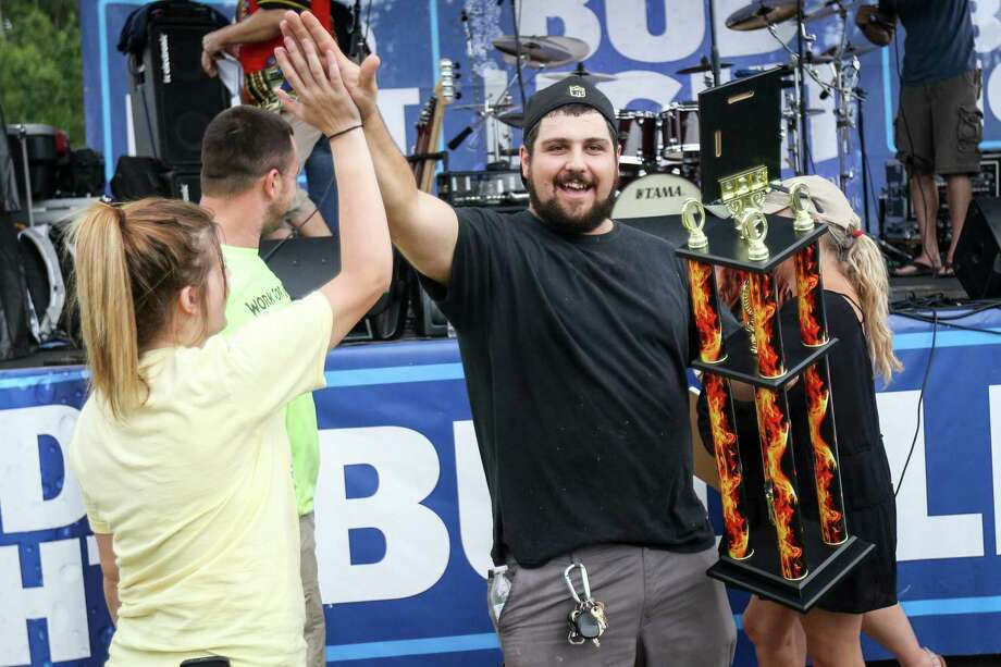 Jessie Mallas, owner of The Greek Squad, accompanied by his friends Brianna Keller and Johnathan Harper, celebrates after earning first place burger during the 3rd Annual Throwdown Texas Burger & Music Festival on Saturday, June 9, 2018, at Town Green Park in The Woodlands. Photo: Michael Minasi, Staff Photographer / Houston Chronicle / © 2018 Houston Chronicle