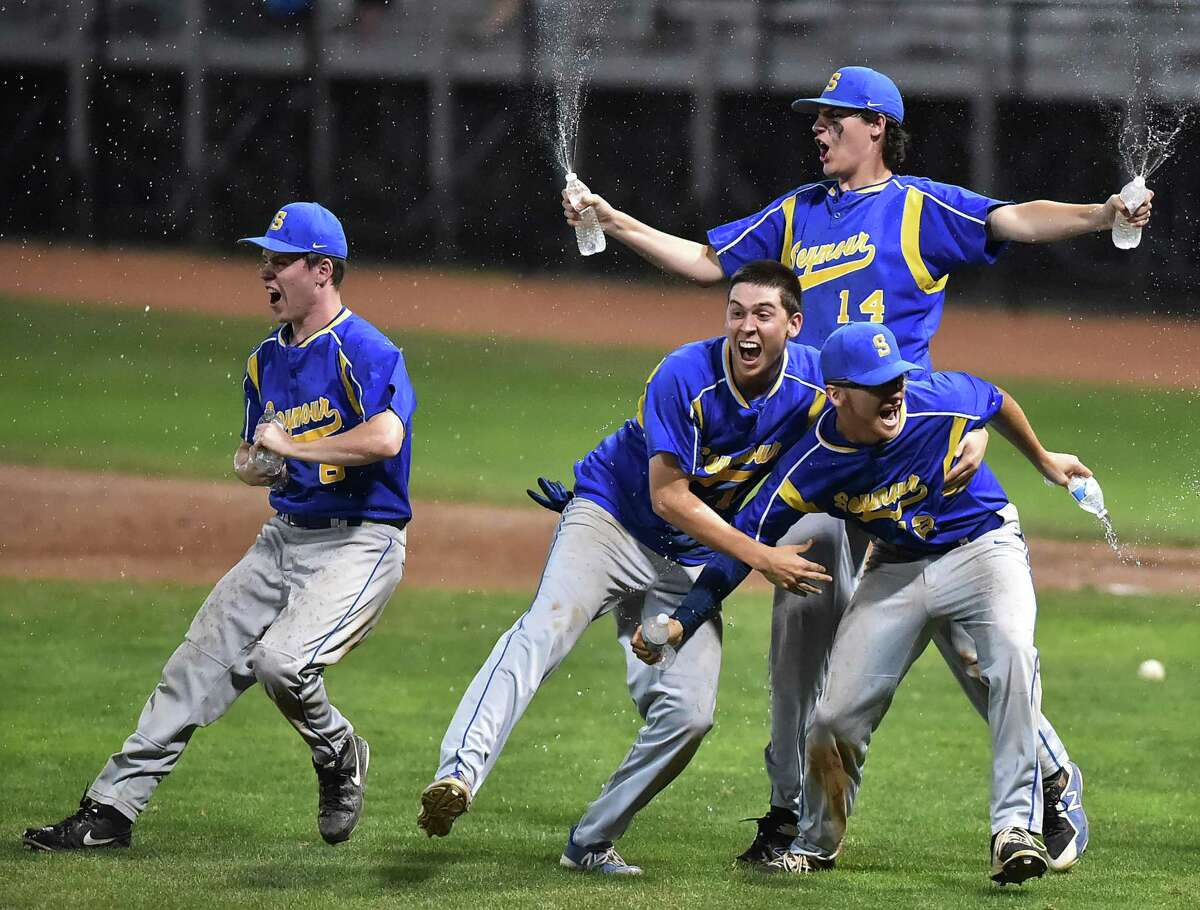 Seymour celebrates their 13-2 win over Wolcott for the Class M championship title, Saturday, June 9, 2018, at Palmer Field in Middletown.