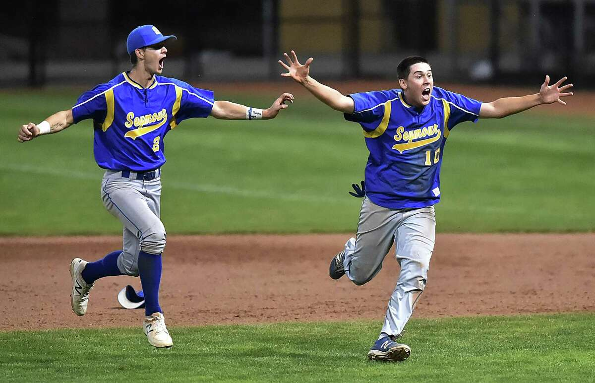 Seymour senior Austin DeRosa (21) and Brandon Ellsworth (10) celebrate their championship win over Wolcott for the Class M title, Saturday, June 9, 2018, at Palmer Field in Middletown. The Wildcats won, 13-2.