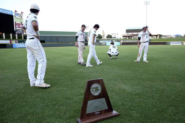 Rattler players wander around dejected as Reagan loses 7-2 in the 6A state championship game to Southlake Carroll at Dell Diamond on June 9, 2018.