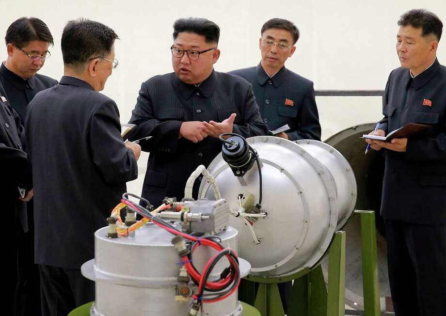 "FILE - This undated file image distributed Sept. 3, 2017, by the North Korean government, shows North Korean leader Kim Jong Un at an undisclosed location. An unknown number of nuclear warheads. Stockpiles of plutonium and uranium. ICBMs. Weapons factories - and the scientists who work at them. The list of what it would take for the ""complete denuclearization"" of North Korea is long. North Korea has said it's willing to deal away its entire nuclear arsenal if the United States provides it with a reliable security assurance and other benefits. (Korean Central News Agency/Korea News Service via AP, File) / KCNA via KNS"
