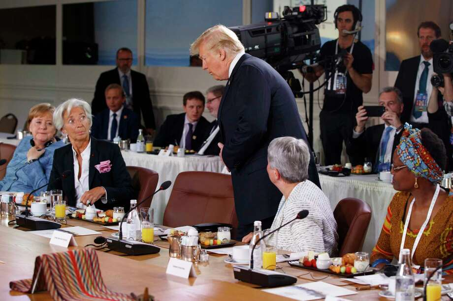 President Donald Trump arrives for a Gender Equality Advisory Council breakfast during the G-7 summit, Saturday, June 9, 2018, in Charlevoix, Canada. From left, German Chancellor Angela Merkel, IMF Managing Director Christine Lagarde, Trump, Christine Whitecross, and Winnie Byanyima. (AP Photo/Evan Vucci) Photo: Evan Vucci / Copyright 2018 The Associated Press. All rights reserved.