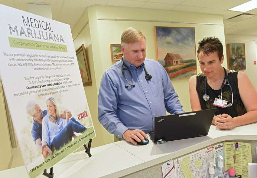 Dr. Eric Schnakenberg, a physician at Community Care Family Medicine in Clifton Park, and his colleague, Julia Gross, a nurse practitioner stand in their facility on Thursday, June 8, 2018 in Clifton Park, N.Y. They are among a small but growing number of practitioners in New York who have found success weaning patients off of opioids and onto medical marijuana for their chronic pain. (Lori Van Buren/Times Union)