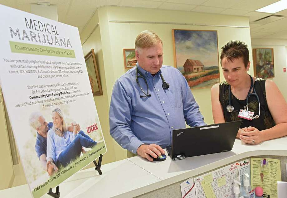 Dr. Eric Schnakenberg, a physician at Community Care Family Medicine in Clifton Park, and his colleague, Julia Gross, a nurse practitioner stand in their facility on Thursday, June 8, 2018 in Clifton Park, N.Y. They are among a small but growing number of practitioners in New York who have found success weaning patients off of opioids and onto medical marijuana for their chronic pain. (Lori Van Buren/Times Union) Photo: Lori Van Buren / 20044028A