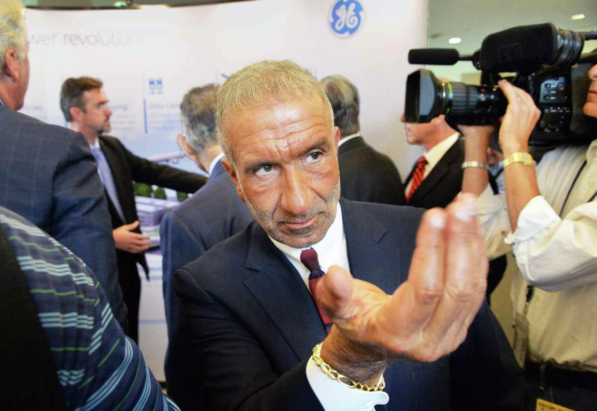 Albany Nanocollege CEO Alain Kaloyeros calls to an associate during the announcement of a new $500 million power electronics manufacturing consortium in the Capital Region at GE Global Research Tuesday July 15, 2014, in Niskayuna, NY. (John Carl D'Annibale/Times Union archive)
