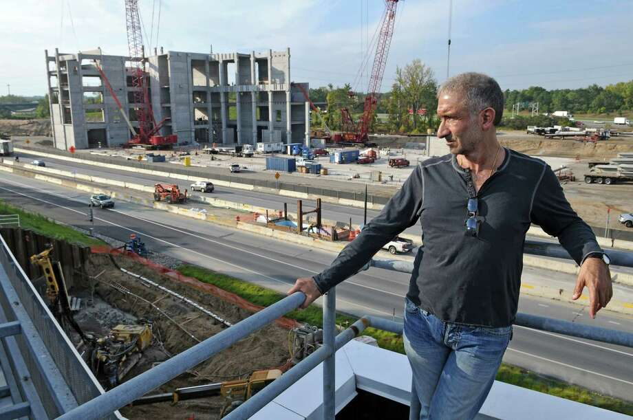 Dr. Alain E. Kaloyeros, Senior Vice President and Chief Executive Officer, College of Nanoscale Science and Engineering, watches new construction across Washington Avenue Extension at the college on Tuesday Sept. 27, 2011 in Albany, NY.  ( Philip Kamrass/Times Union) Photo: Philip Kamrass / 00014779A