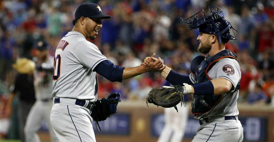Houston Astros relief pitcher Hector Rondon (30) and catcher Max Stassi (12) celebrate the team's 4-3 victory over the Texas Rangers during the ninth inning of a baseball game Saturday, June 9, 2018, in Arlington, Texas. (AP Photo/Michael Ainsworth) Photo: Michael Ainsworth/Associated Press
