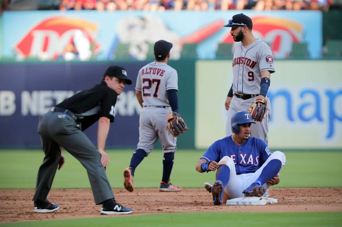 The Texas Rangers' Ronald Guzman reaches second base on an error by Houston Astros second baseman Jose Altuve (27) in the second inning at Globe Life Park in Arlington, Texas, on Saturday, June 9, 2018. (Rodger Mallison/Fort Worth Star-Telegram/TNS)