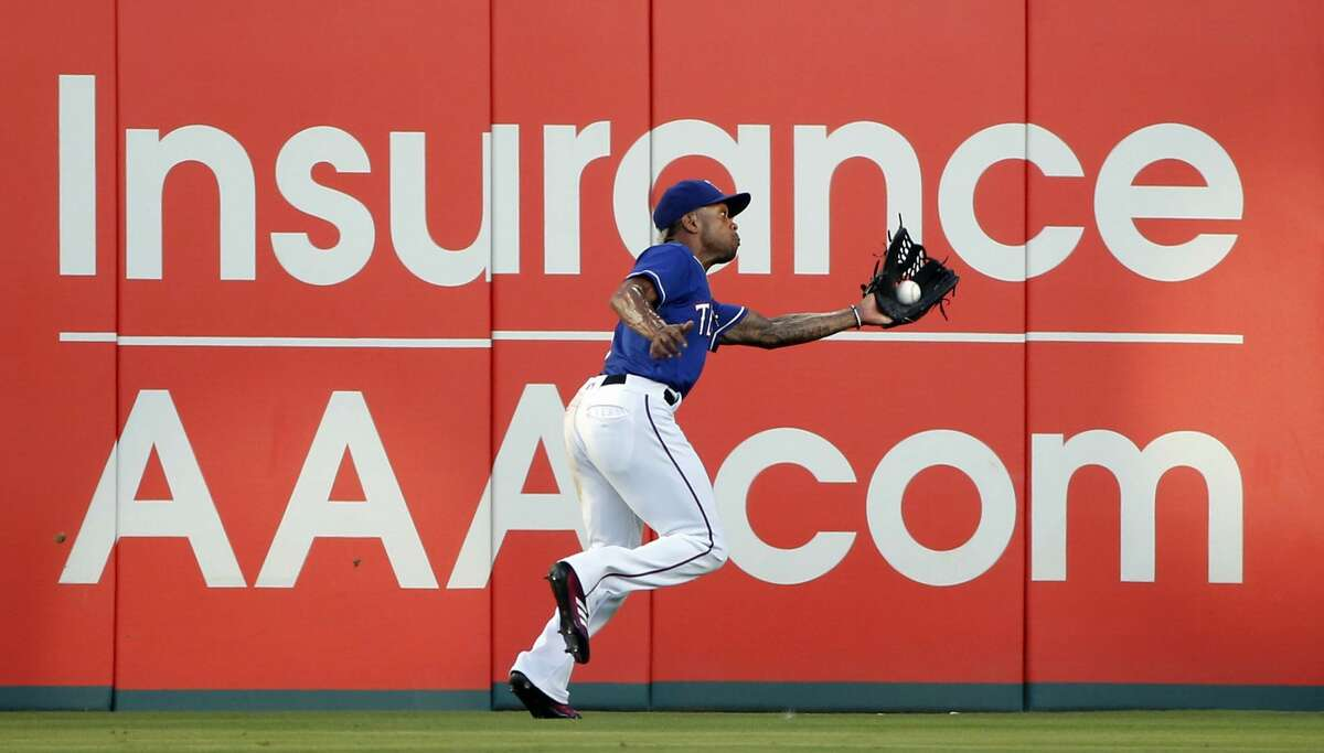 Texas Rangers center fielder Delino DeShields catches a ball hit by Houston Astros' Jose Altuve to end the third inning of a baseball game Saturday, June 9, 2018, in Arlington, Texas. (AP Photo/Michael Ainsworth)