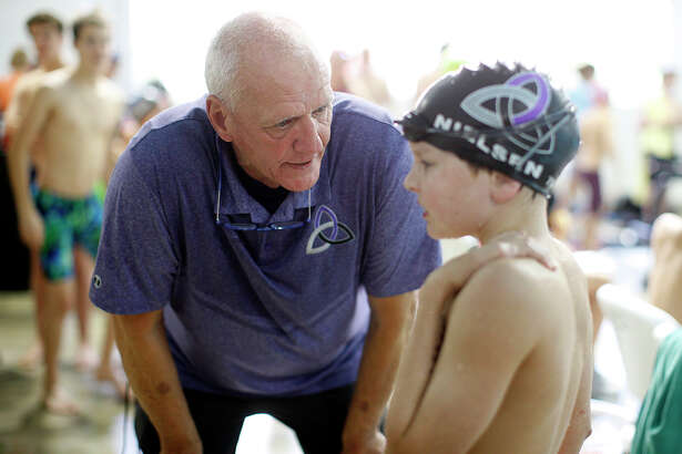Austin Trinity Aquatic Club coach Doug Russell, former Midlander and Olympian, advises a competitor during the Frost Bank Summer Invitational June 9, 2018 at the FMH Foundation Natatorium. James Durbin/Reporter-Telegram