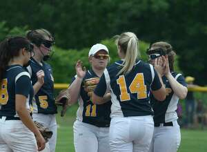 Averill Park softball players hi-five at the start of an inning during the Class A semifinal against Maine-Endwell in Moreau, N.Y., on Saturday, Jun. 9, 2018. (Jenn March, Special to the Times Union)
