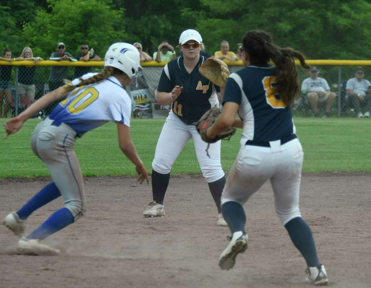 Averill Park infielders Bryanna Agan (11) and Syd Haskin toss the ball back and forth to tag out Maine-Endwell's Melissa Demo during the Class A semifinal in Moreau, N.Y., on Saturday, Jun. 9, 2018. (Jenn March, Special to the Times Union)