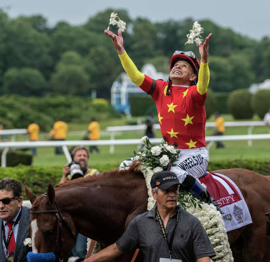 Click through to see Justify's journey to the Triple Crown. JockeyMike Smith is jubilant after holding off the competition with Justify and winning the 150th running of the Belmont Stakes and the coveted Triple Crown of Thoroughbred race at Belmont Park Saturday June 9, 2018, in Elmont, N.Y.  (Skip Dickstein/Times Union)  Photo: SKIP DICKSTEIN