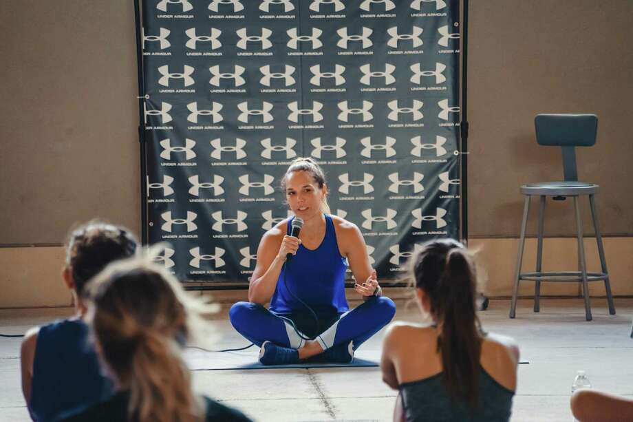 "Lindsey Torgerson of Team USA Duathlon led a ""Mind and Mobility"" class at The Outlet Shoppes at Laredo on Saturday. Photo: Courtesy Of Phrank Photography"