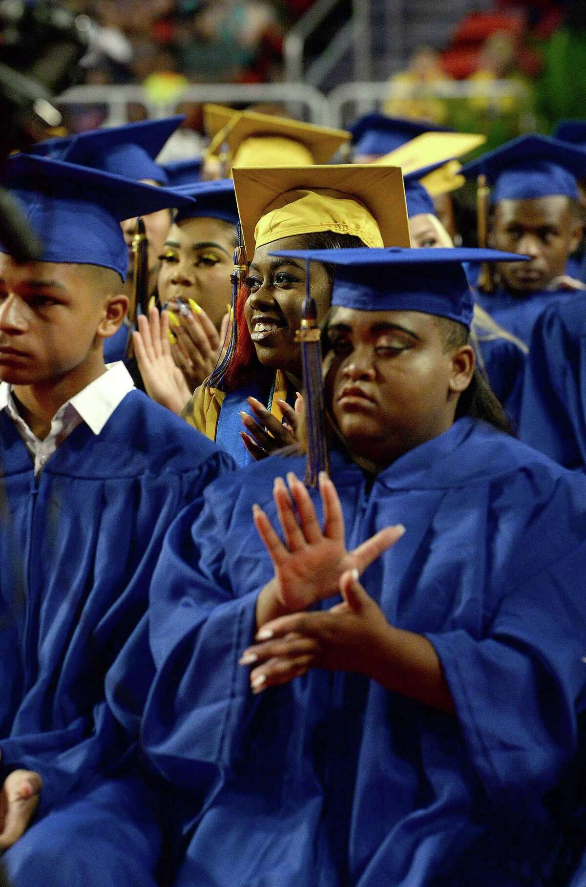 Graduates take in the speakers and ceremony during Ozen's commencement at the Montagne Center. Central and Ozen graduated their final classes Saturday, June 9, as the Class of 2019 will be the first to matriculate under the newly-formed Beaumont United High School. Photo taken Saturday, June 9, 2018 Kim Brent/The Enterprise