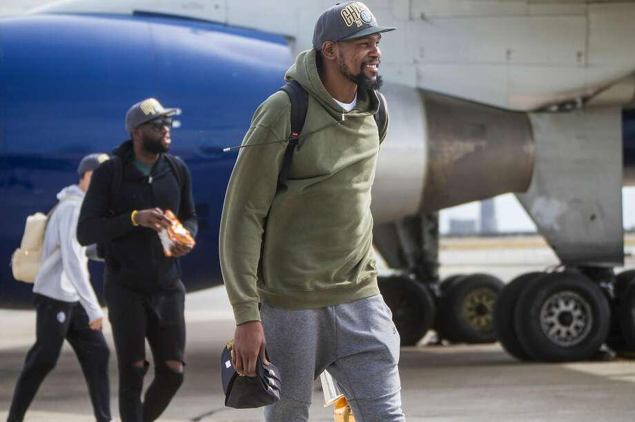 The Golden State Warriors' Kevin Durant carries his MVP trophy as he arrives from Cleveland, Ohio at Landmark Aviation in Oakland, Calif. Saturday, June 9, 2018. after defeating the Cleveland Cavaliers in the NBA Finals. Photo: Jessica Christian / The Chronicle