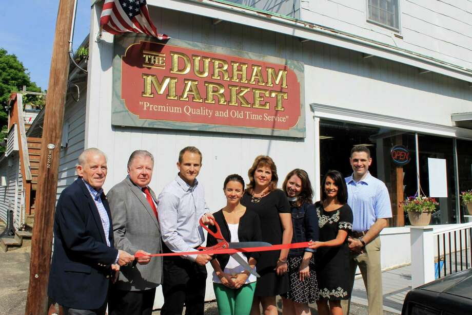 The Durham Market held a ribbon cutting June 8. From left are Middlesex County Chamber of Commerce President Larry McHugh, Chairman Jay Polke, market owner Walter Tregoning, owner Lisa Tregoning, Durham First Selectwoman Laura Francis, the Rev. Jeanette Hicks of the United Churches of Durham, market owner Reshma Patel. Photo: Contributed Photo