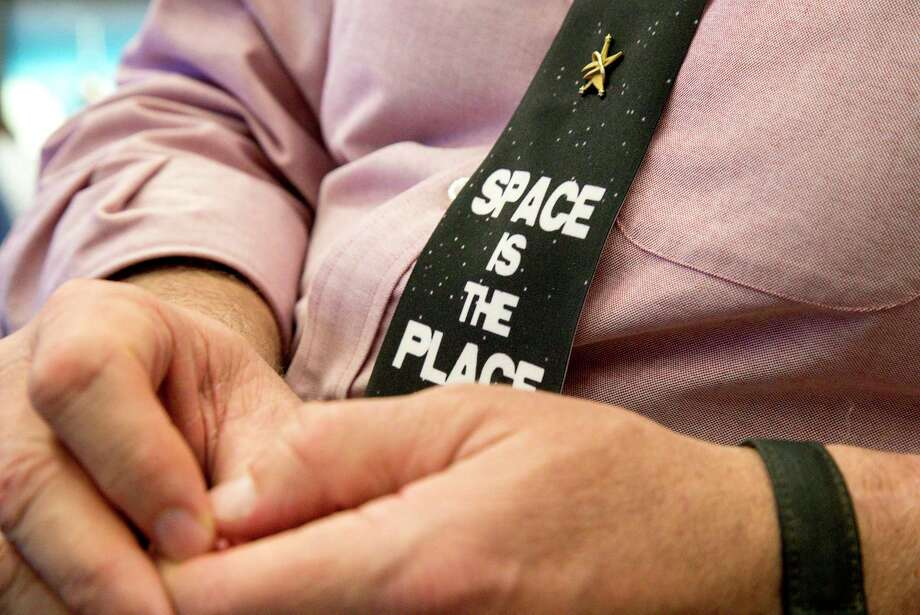 """Timothy """"T.J."""" Creamer, right, a former astronaut and current mission control flight director at N.A.S.A., wears a tie that reads, """"Space is the Place,"""" in the mission control room at the Johnson Space Center, Friday, April 27, 2018, in Houston. Photo: Jon Shapley, Houston Chronicle / © 2018 Houston Chronicle"""