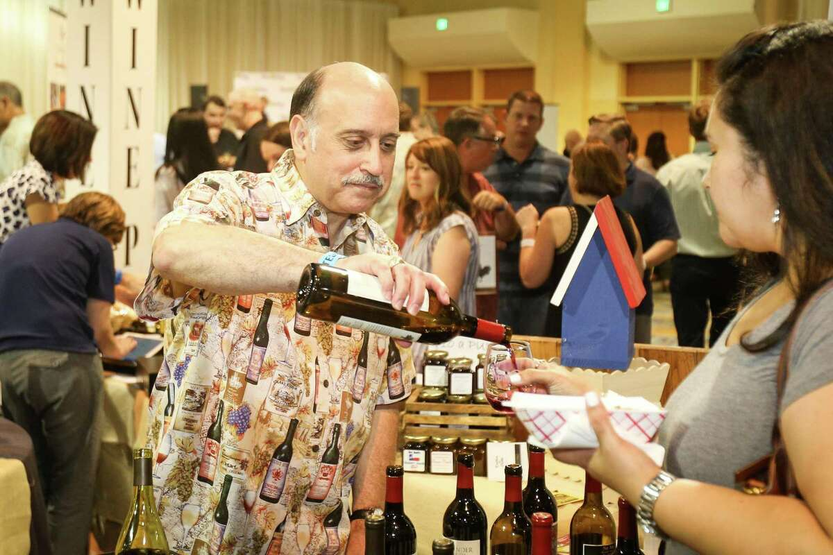 Volunteer Mike Nicolosi serves wines from Alexander Valley Vineyard during Sips, Suds & Tacos on Friday, June 8, 2018, at the Woodlands Waterway Marriott Hotel and Convention Center.