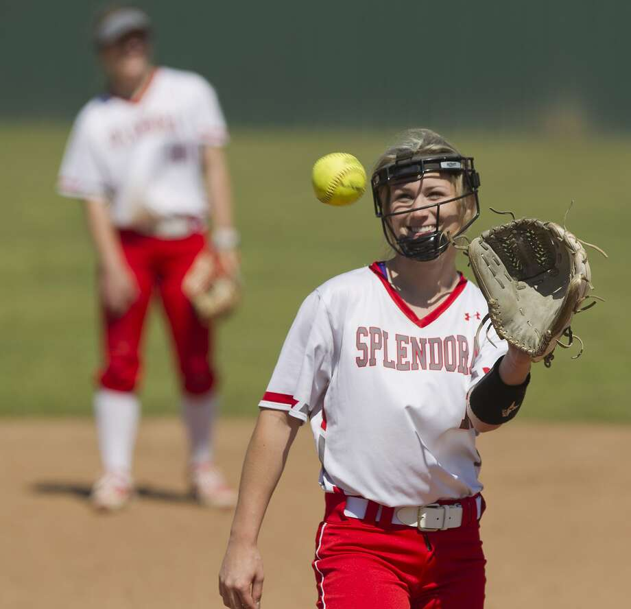 Splendora relief pitcher Caleigh Millican (14) shares a smile after a call during the sixth inning of a District 21-5A high school softball game at Splendora High School, Wednesday, March 14, 2018, in Splendora. Photo: Jason Fochtman, Houston Chronicle