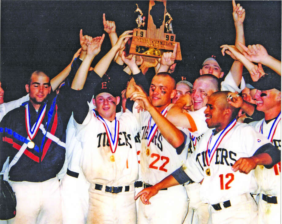 The Edwardsville Tigers celebrating with the Class AA state championship trophy after defeating Tinley Park Andrew in the state title game.