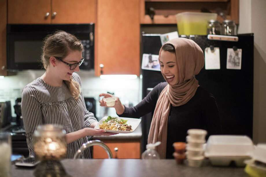 Noha Sahnoune, right, breaks fast with her friend Emma Armer during the holy month of Ramadan. Photo: Marie D. De Jesus, Houston Chronicle / Houston Chronicle / © 2018 Houston Chronicle