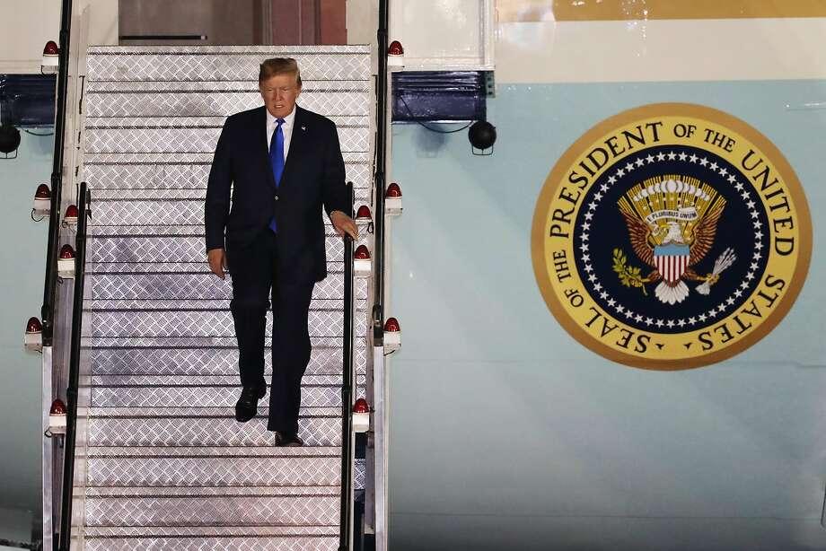 U.S. President Donald Trump disembarks from Air Force One at the Paya Lebar Air Base in Singapore, on Sunday, June 10, 2018. U.S. Pres Photo: SeongJoon Cho, Bloomberg