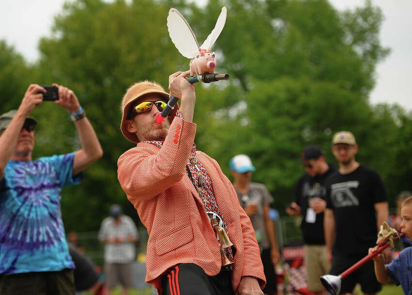 Creative kazoo maker Patrick Shea, of Wolcott, plays along with the music at the Riverfront Music Festival in Shelton, Conn. on Sunday, June 10, 2018.