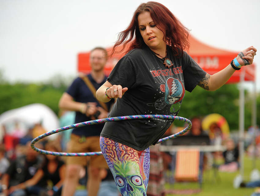 Sara Fegan, of Naugatuck, hula hoops to the music at the Riverfront Music Festival in Shelton, Conn. on Sunday, June 10, 2018.