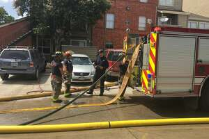 San Antonio firefighters say up to 40 residents could be displaced if officials can not get power restored after a fire at a N.E. Side apartment complex Sunday, June 10, 2018, needed 18 units from the San Antonio Fire Department to contain.
