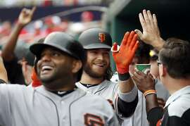 San Francisco Giants' Brandon Crawford, center, celebrates his two-run homer that knocked in Pablo Sandoval, left, during the fourth inning of a baseball game against the Washington Nationals at Nationals Park, Sunday, June 10, 2018, in Washington. (AP Photo/Alex Brandon)
