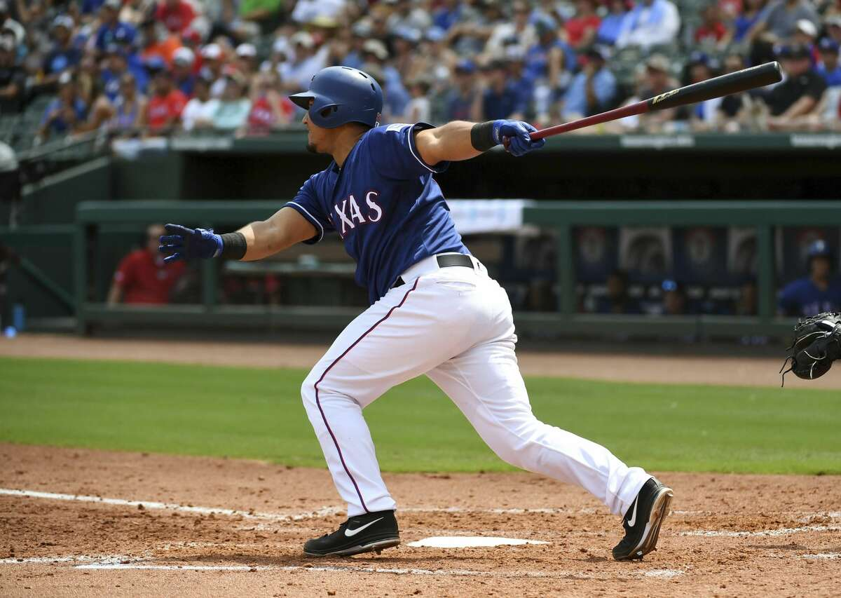 Texas Rangers' Carlos Perez follows through on an two-run single during the third inning of a baseball game against the Houston Astros, Sunday, June 10, 2018, in Arlington, Texas. Perez advanced to second on the play. (AP Photo/Jeffrey McWhorter)
