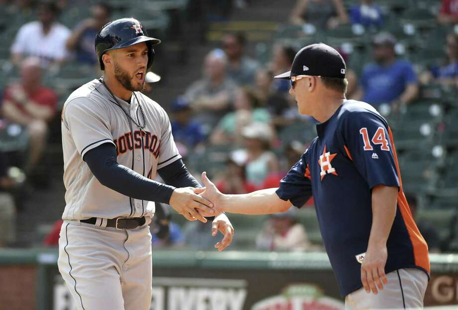 Houston Astros' George Springer, left, is congratulated by Houston Astros manager AJ Hinch, right,  after scoring the winning run on a balk by Texas Rangers relief pitcher Keone Kela during the ninth inning of a baseball game, Sunday, June 10, 2018, in Arlington, Texas. Houston won 8-7. (AP Photo/Jeffrey McWhorter) Photo: Jeffrey McWhorter, FRE / Associated Press / FR170451 AP