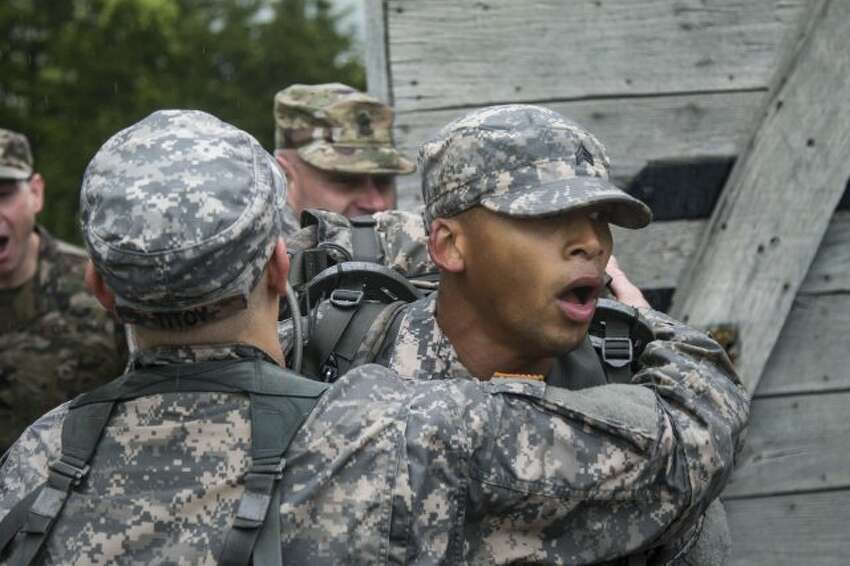 Sgt. Quentin Davis of Headquarters Company, 1st Battalion, 69th Infantry Regiment, completes the 12-mile ruck march portion of the competition. (Spc. Amouris Coss / New York Army National Guard)