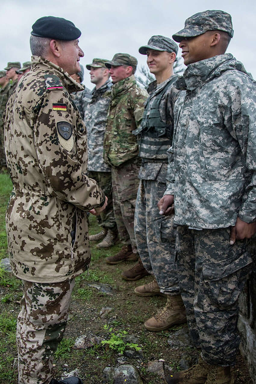 Sgt. Quentin Davis receives the German Armed Forces Proficiency Badge from German Army Lt. Col. Michael Breuer, the German liaison officer to the U.S. Military Academy, during the Region 1 Best Warrior Competition at U.S. Military Academy at West Point. (Spc. Amouris Coss / New York Army National Guard)