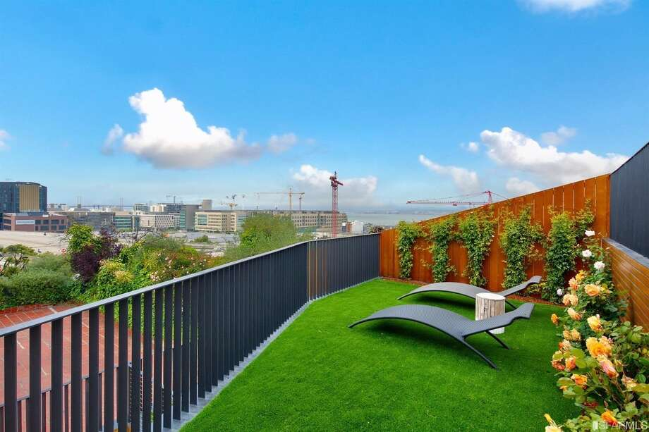 This brand new condo on Potrero's North Slope has a personal lawn in the sky and views to match. Asking just shy of $3 million. Photo: Circle Visions Via Gina Nibbi/Pacific Union