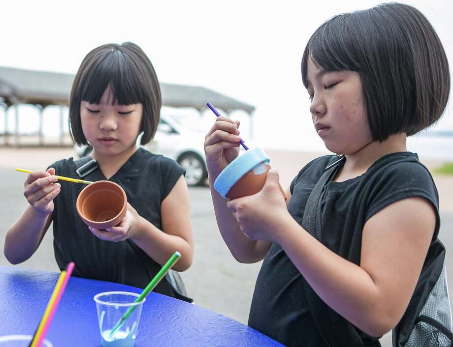 Twin sisters Laura(L) and Mary Chen of New Haven paint clay pots as part of the 18th annual Lead Awareness Picnic held Sunday at Lighthouse Point Park. Photo: (C)JOHN H VANACORE / (c)John H.Vanacore