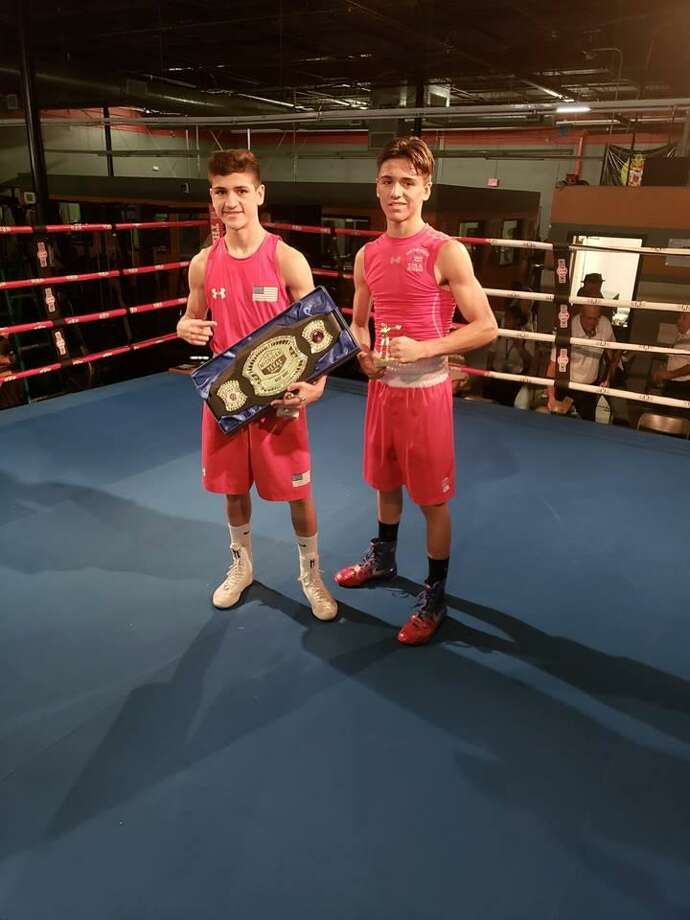 Emilio Garcia and Angel Garcia from Baby Joey's Boxing Club helped their team win in a Texas vs. Michigan tournament Saturday in Austin. Photo: Courtesy Photo