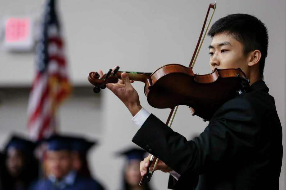 Liberty High School senior Song Gao, 18, plays the violin during the graduation ceremony for himself and his classmates at Houston Baptist University Sunday, June 10, 2018 in Houston. The small high school helps students who recently immigrated to the U.S. obtain their high school degrees. Photo: Michael Ciaglo, Houston Chronicle / Michael Ciaglo