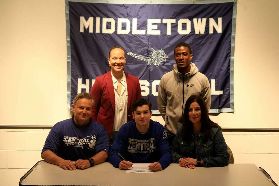 Jeff Turro will continue his soccer career at Central Connecticut State University. From row, from left, his dad Jeff, Jeff Turro and his mom Cheryl; back row, from left, Middletown athletic director Elisha De Jesus and assistant coach Matt Harris. Photo: Contributed Photo