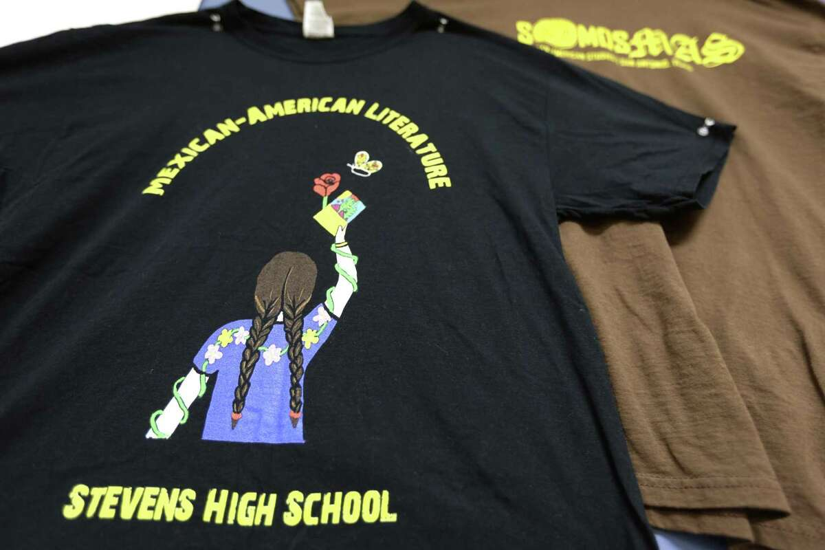 A t-shirt designed for Stevens High School teacher Andres Lopez's Mexican American literature elective class hangs on Lopez's classroom wall June 6, 2018.